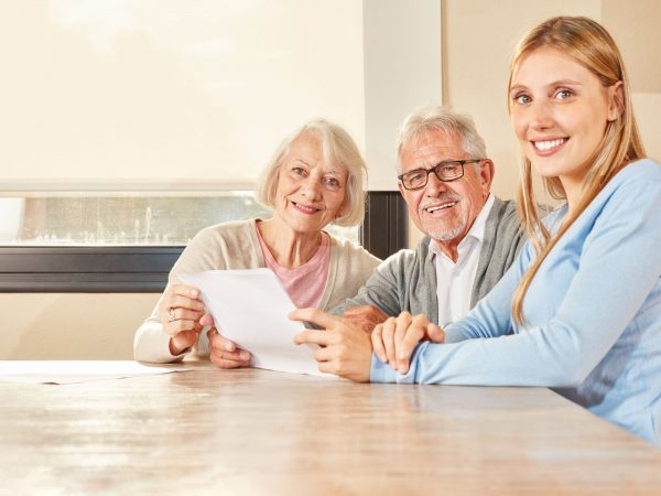 Daughter and senior couple with contract of insurance or evaluation of pension