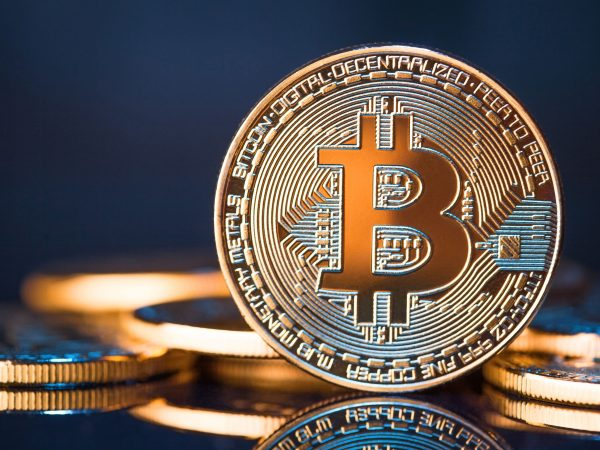 Golden Bitcoins on a blue background. New virtual money