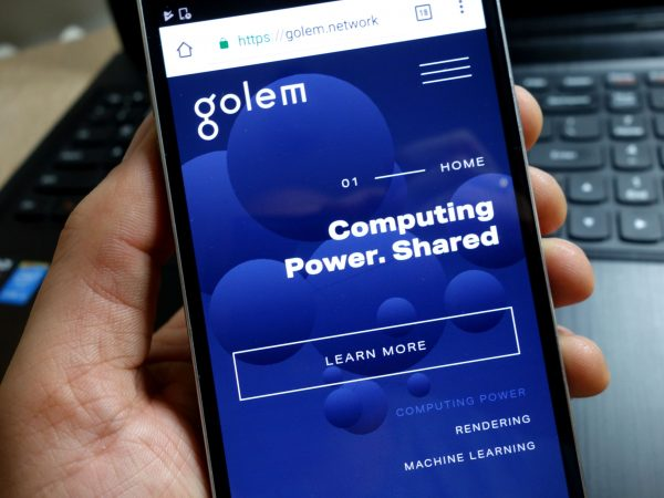 104406674 – konskie, poland – may 07, 2018: smartphone with golem crypto currency homepage golem.net work displayed lying on a calculator