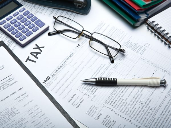 44968826 – office work and filling in tax returns close up