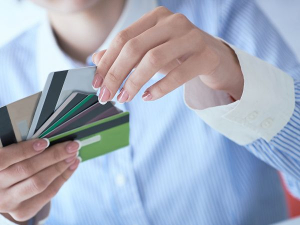 Woman hand holding various credit cards close-up.