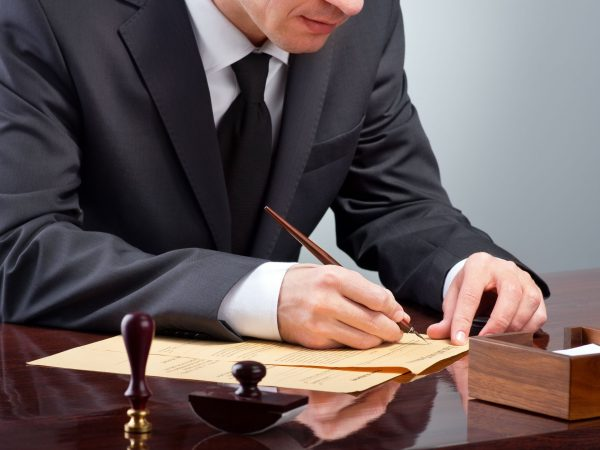 53034405 – businessman notarize testament at notary public office