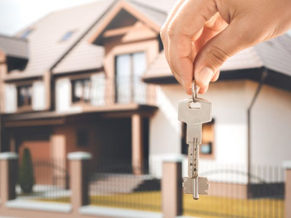 Young woman rent apartment real estate agency holding keys